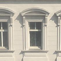 Übereifrige Putzfrau am Fenstersims in Wien-Landstraße