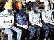 Die Angeklagten auf der Anklagebank des Großen Schwurgerichtssaal des Wiener Landesgerichts.