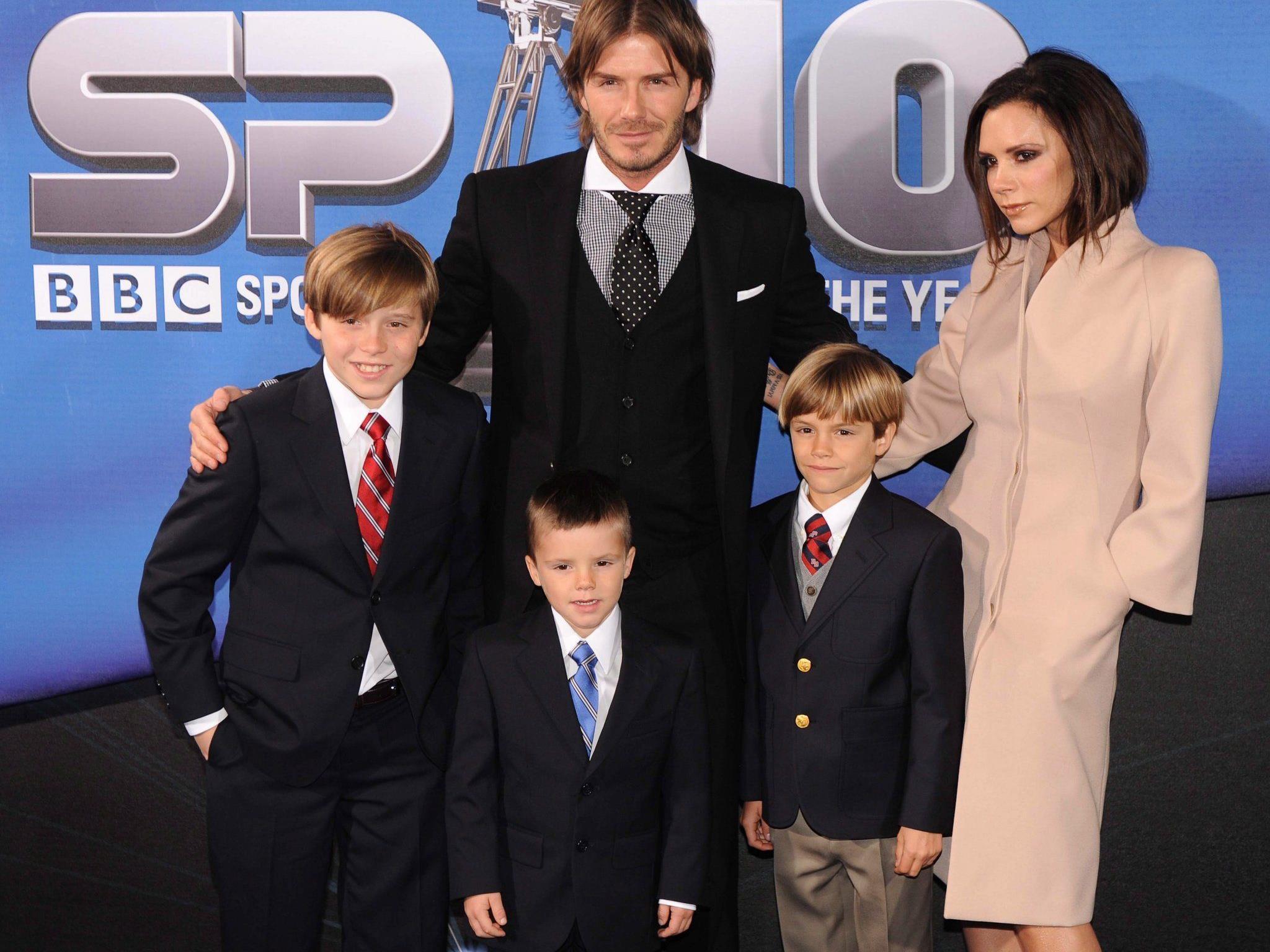 David und Victoria Beckham mit ihren Söhnen Brooklyn, Romeo und Cruz.