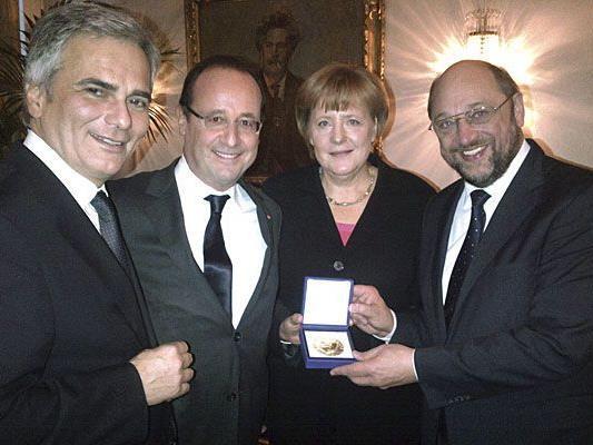 Werner Faymann, Francois Hollande, Angela Merkel und Martin Schulz bei der offiziellen Friedensnobelpreis-Verleihung am Montag in Oslo