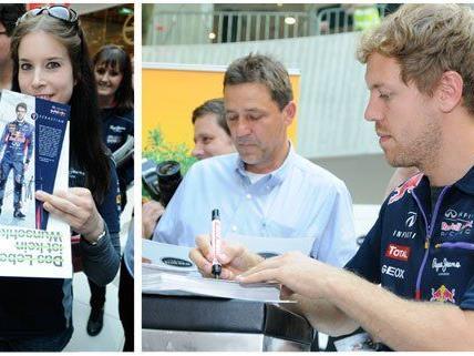 Sebastian Vettel und Daniel Ricciardo gaben eine Autogrammstunde.