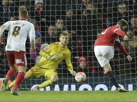 Durch ein Elfertor von Rooney rutschte Man Utd. eine Runde weiter