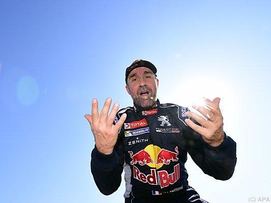 Peterhansel gewann je sechsmal auf dem Motorrad und im Auto
