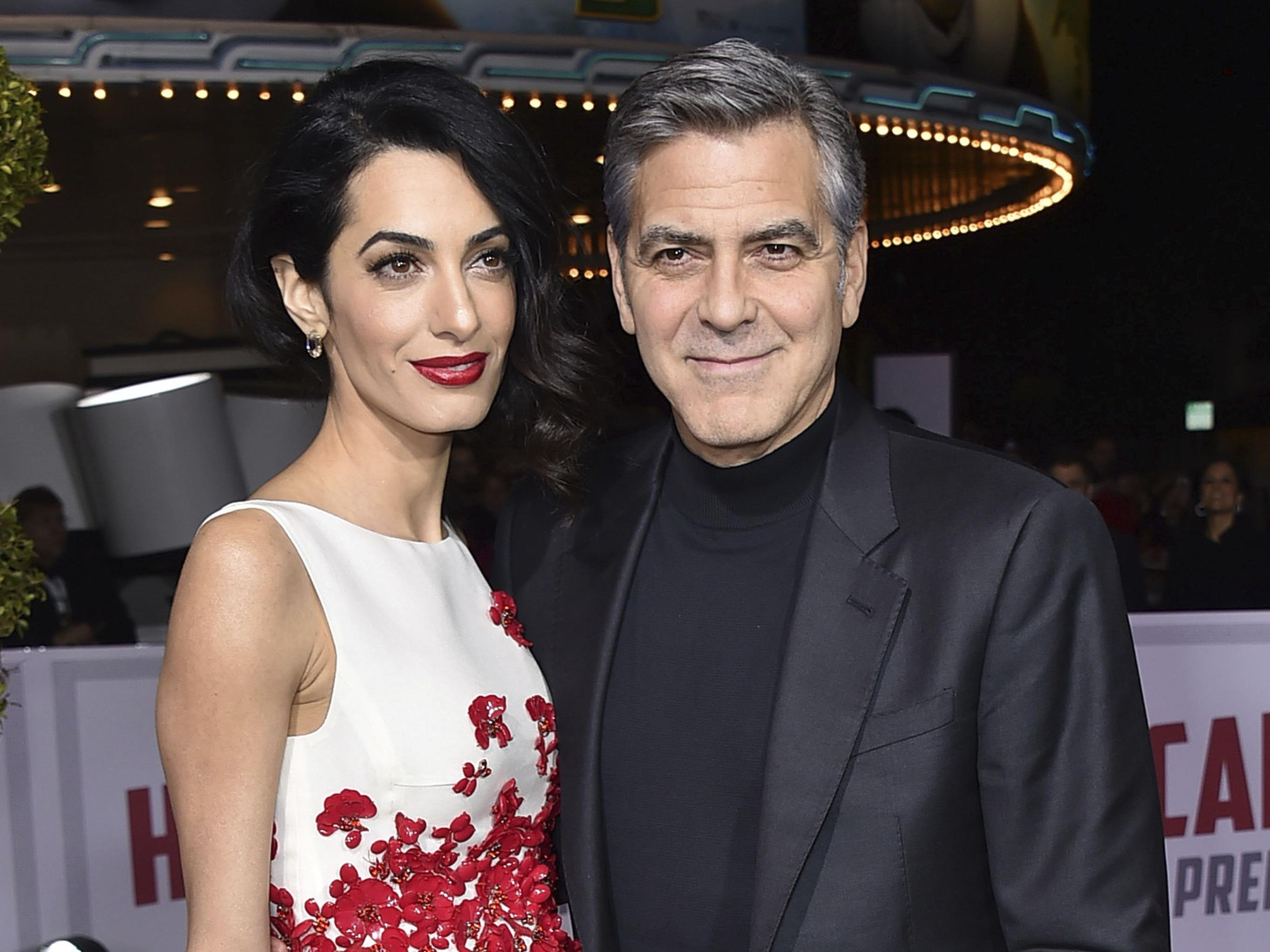 George Clooney und seine Frau Amal erwarten Medienberichten zufolge Zwillinge.